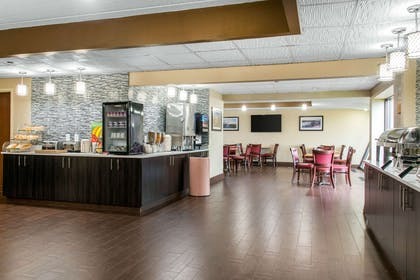 Enjoy breakfast in this seating area | Quality Inn & Suites Mall of America - MSP Airport