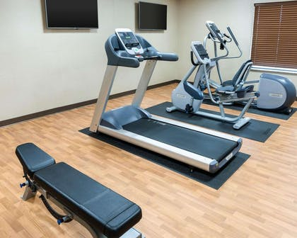 Exercise room with cardio equipment and weights | Comfort Inn & Suites West - Medical Center