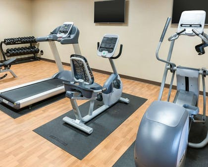 Exercise room with television | Comfort Inn & Suites West - Medical Center