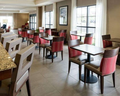 Enjoy breakfast in this seating area | Comfort Inn & Suites West - Medical Center