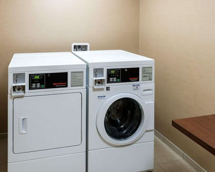 Guest laundry facilities | Comfort Inn & Suites West - Medical Center