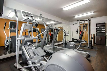Fitness center with cardio equipment and weights   Quality Suites St. Joseph
