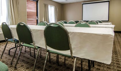 Meeting room with classroom-style setup   Quality Suites St. Joseph