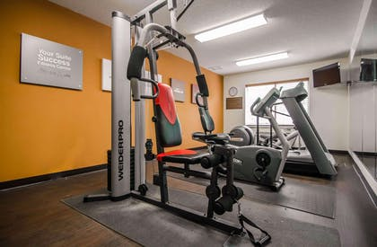 Fitness center with television   Quality Suites St. Joseph