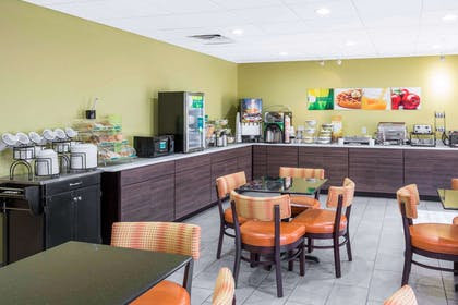 Enjoy breakfast in this seating area | Quality Inn & Suites Arnold - St Louis
