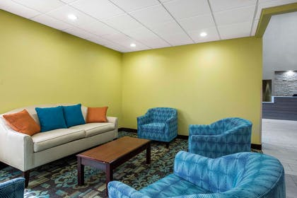 Spacious lobby with sitting area | Quality Inn & Suites Arnold - St Louis
