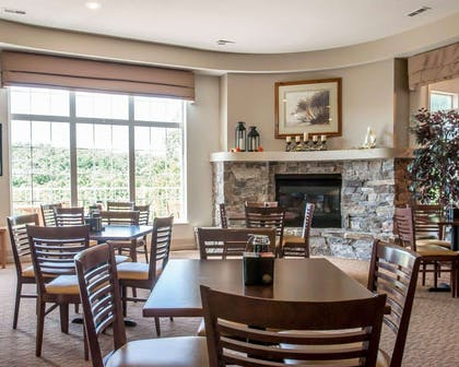 Enjoy breakfast in this seating area | Sleep Inn & Suites Lake of the Ozarks