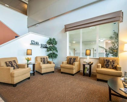 Spacious lobby with sitting area | Sleep Inn & Suites Lake of the Ozarks