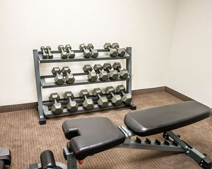 Exercise room with free weights | Sleep Inn & Suites Lake of the Ozarks