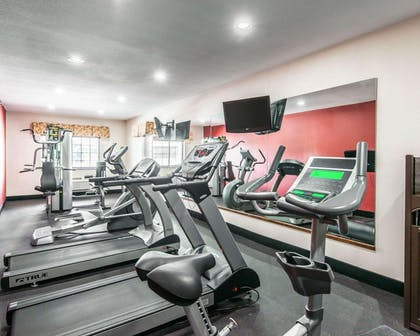 Exercise room with cardio equipment and weights | Comfort Inn & Suites Kansas City Downtown