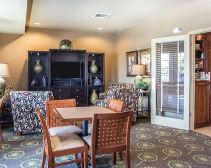 Spacious lobby with sitting area | MainStay Suites St. Robert - Fort Leonard Wood