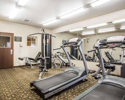 Fitness center with cardio equipment and weights | MainStay Suites St. Robert - Fort Leonard Wood