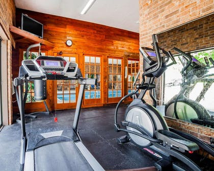 Fitness center with television | Quality Inn & Suites Kansas City Airport North