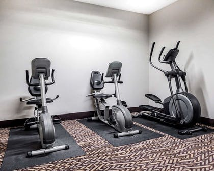 Fitness center with cardio equipment | Quality Inn & Suites Kansas City Airport North
