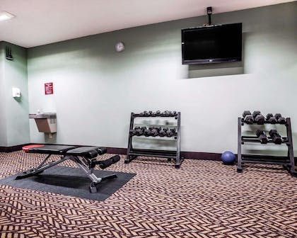 Fitness center with free weights | Quality Inn & Suites Kansas City Airport North