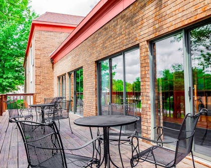 Relax on the hotel patio | Quality Inn & Suites Kansas City Airport North