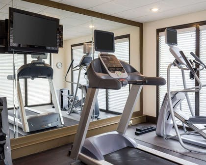 Exercise room with television | Comfort Suites Starkville
