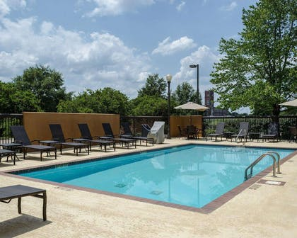 Outdoor pool with sundeck | Comfort Suites Starkville