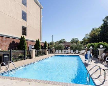 Outdoor pool with sundeck | Comfort Suites Olive Branch West