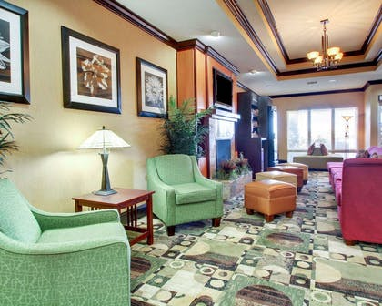 Lobby with fireplace | Comfort Suites Vicksburg