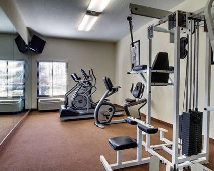Exercise room with cardio equipment and weights | Comfort Inn Moss Point - Pascagoula