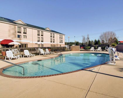 Outdoor pool with sundeck | Comfort Inn Moss Point - Pascagoula