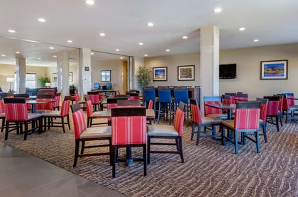 Enjoy breakfast in this seating area | Comfort Suites Airport