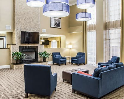 Spacious lobby with sitting area | Comfort Suites University - Research Park