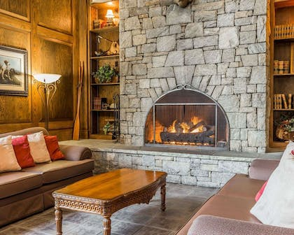 Lobby with fireplace | Comfort Suites Boone - University Area