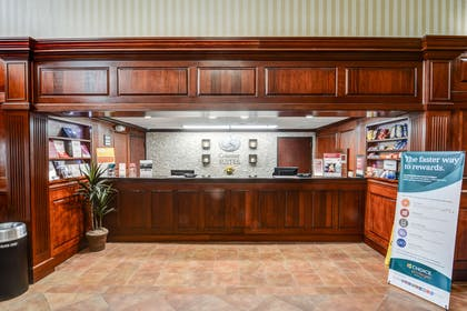 Front desk with friendly staff | Comfort Suites Outlet Center
