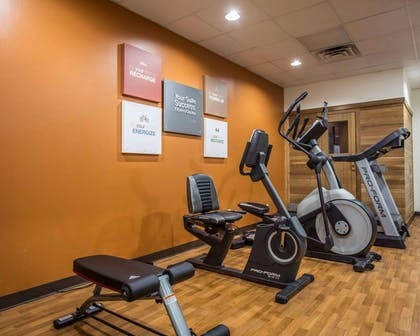 Fitness center with cardio equipment and weights   Comfort Suites Lumberton