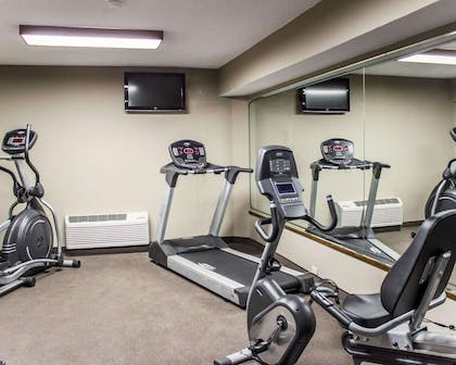 Exercise room with cardio equipment and weights   Sleep Inn & Suites Near Ft. Bragg