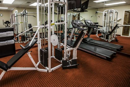 Fitness center with cardio equipment and weights | Mainstay Suites Wilmington