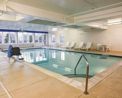 Indoor pool with lounge area | Comfort Suites Airport
