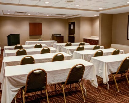 Meeting room with classroom-style setup | Comfort Suites Airport