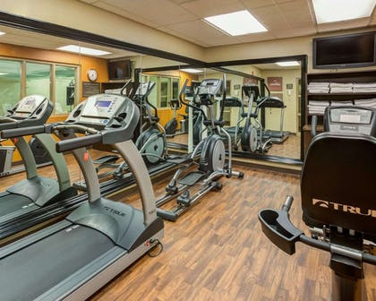 Fitness center with cardio equipment | Comfort Suites Airport