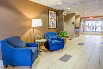 Spacious lobby with sitting area | Comfort Suites Concord Mills