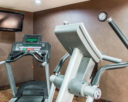 Fitness center with cardio equipment | Quality Inn Raleigh Downtown