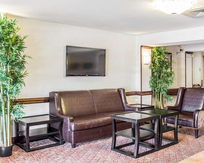 Spacious lobby with sitting area | Quality Inn Raleigh Downtown