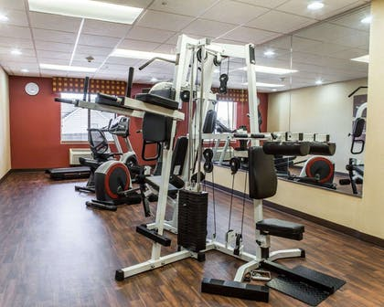 Fitness center with cardio equipment and weights | Comfort Suites Four Seasons