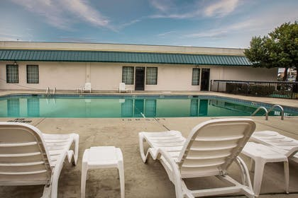 Outdoor pool with sundeck   Quality Inn & Suites Hanes Mall