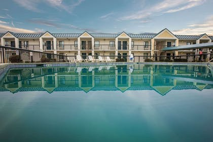 Outdoor pool   Quality Inn & Suites Hanes Mall