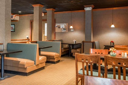 Enjoy breakfast in this seating area   Quality Inn & Suites Hanes Mall