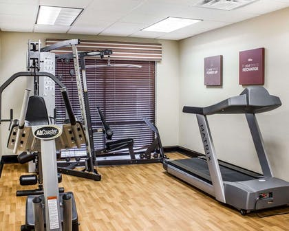 Exercise room with cardio equipment and weights | Comfort Suites Wilson I-95