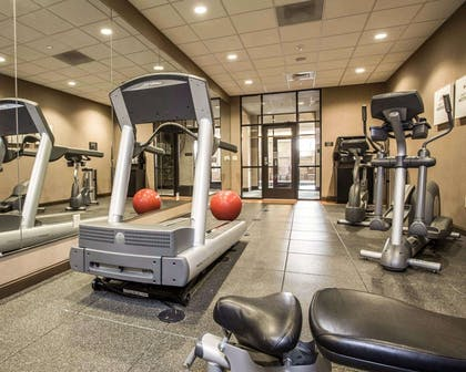 Fitness center with cardio equipment and weights | Comfort Suites Lake Norman - Huntersville