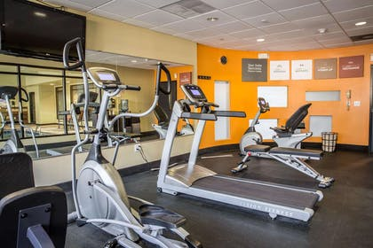 Exercise room with cardio equipment and weights | Comfort Suites New Bern near Cherry Point