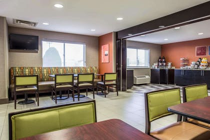 Enjoy breakfast in this seating area | Comfort Inn & Suites Kannapolis - Concord