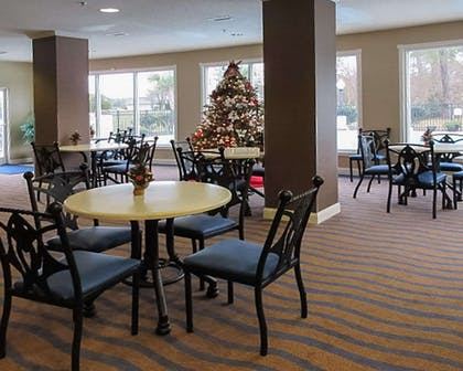 Enjoy breakfast in this seating area | Quality Inn & Suites Sneads Ferry - North Topsail Beach