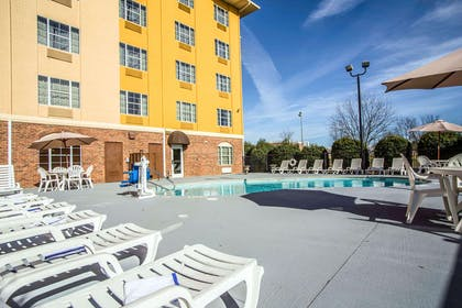 Outdoor pool with sundeck   Comfort Suites Pineville - Ballantyne Area