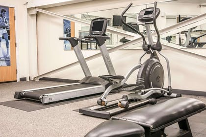 Exercise room with cardio equipment and weights | Sleep Inn & Suites Conference Center and Water Park